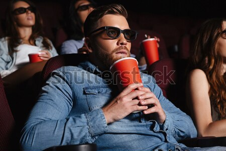 Сток-фото: молодым · человеком · сидят · кино · Смотреть · фильма