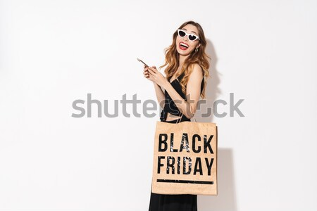 Young Naked woman holding broadsheet Stock photo © deandrobot