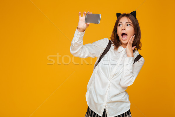 Surpreendido adolescente aluna uniforme mochila Foto stock © deandrobot