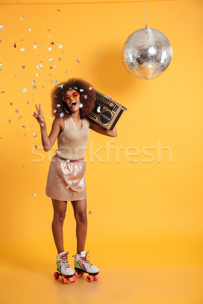 Full length portrait of overjoyed afro american disco woman in s Stock photo © deandrobot