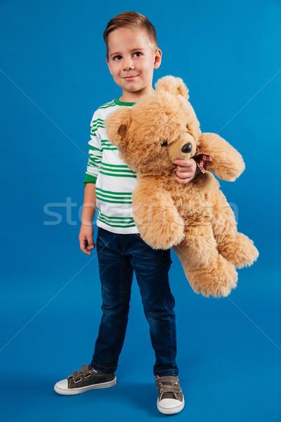 Full length portrait of a little boy holding teddy bear Stock photo © deandrobot