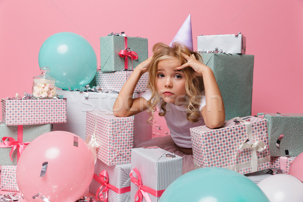 Portrait of a disappointed little girl in a birthday hat Stock photo © deandrobot