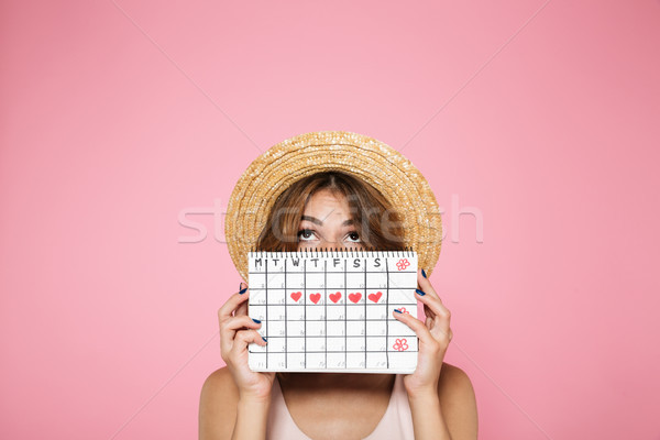Portrait of a young girl in summer hat hiding Stock photo © deandrobot