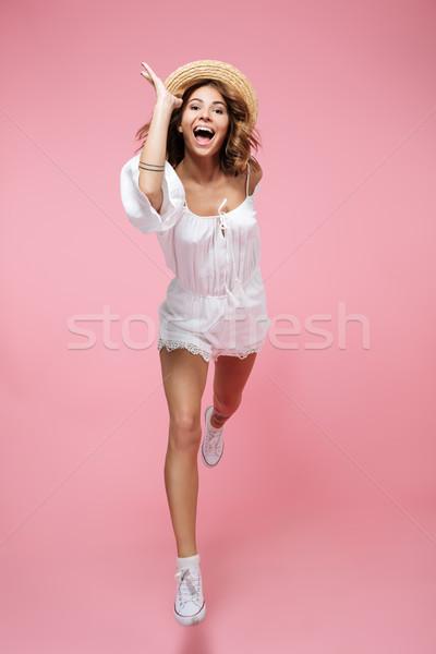 Full length portrait of a happy girl in summer dress Stock photo © deandrobot