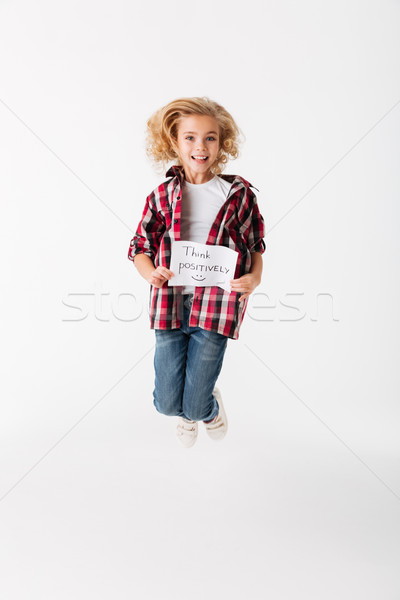Full length portrait of a cheerful little girl Stock photo © deandrobot