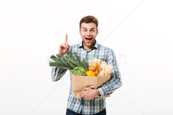 Portré boldog férfi tart papírzacskó tele Stock fotó © deandrobot