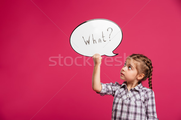 Little girl child standing isolated holding speech bubble. Stock photo © deandrobot