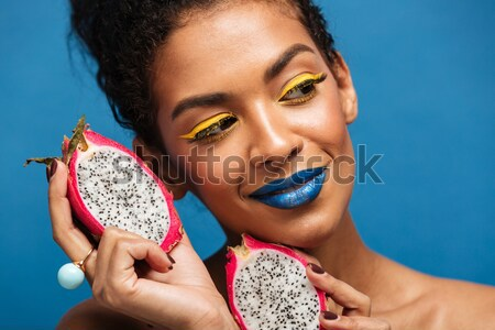 Horizontal image of fancy mulatto woman with colorful makeup and Stock photo © deandrobot