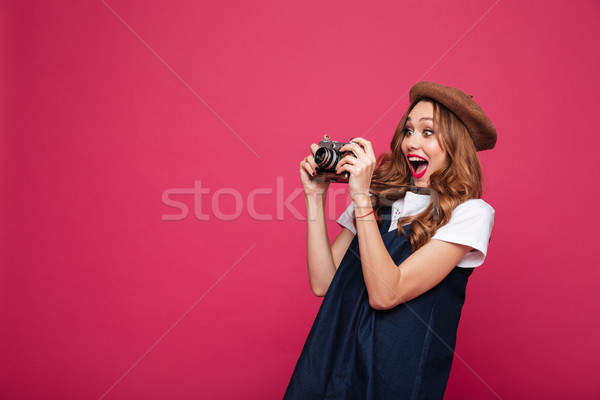 Jovem maravilhado senhora retro câmera Foto stock © deandrobot
