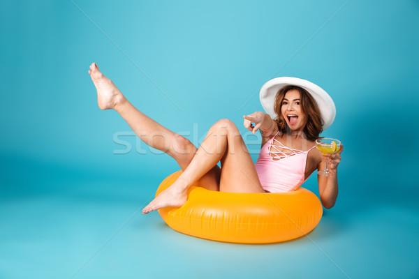 фото возбужденный девушки купальник сидят надувной Сток-фото © deandrobot