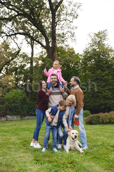 Beautiful big happy family is having fun with golden retriever Stock photo © deandrobot
