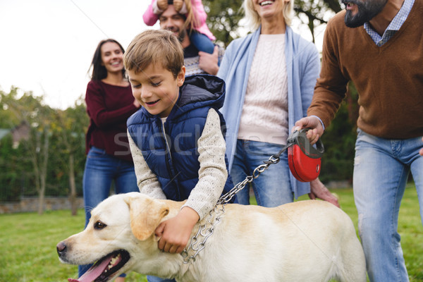 Big happy young family with little son and dog Stock photo © deandrobot