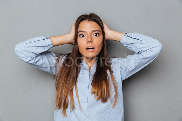 Confused surprised brunette woman in shirt covering her ears Stock photo © deandrobot
