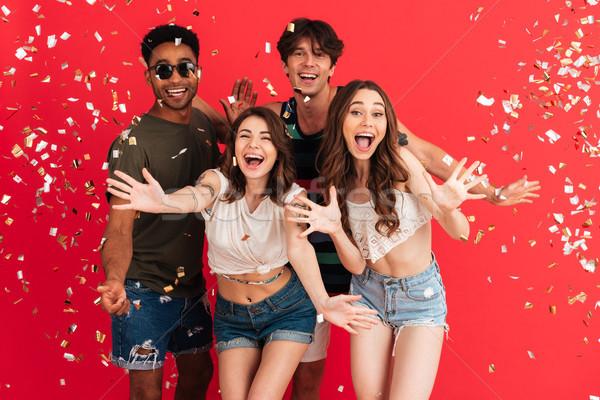 Portrait of a joyful cheery group of multiracial friends Stock photo © deandrobot