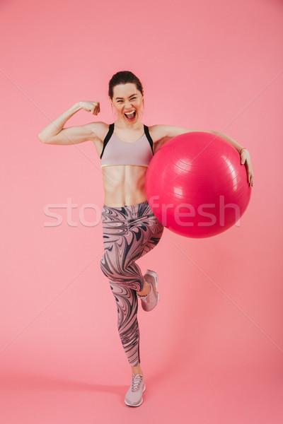 Teljes alakos kép boldog sikít sportoló pózol Stock fotó © deandrobot