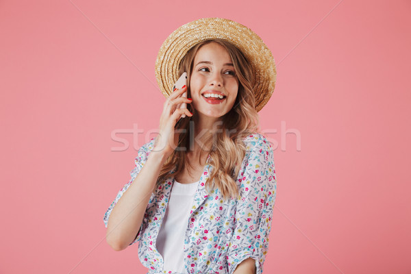 Portrait of a smiling young woman in summer dress Stock photo © deandrobot
