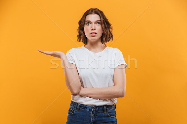 Displeased young lady standing isolated Stock photo © deandrobot