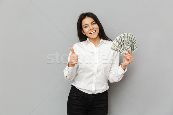 Portrait of successful brunette woman wearing formal outfit hold Stock photo © deandrobot