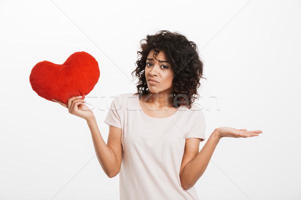 Zdjęcie niezadowolony amerykański kobieta 20s brązowe włosy Zdjęcia stock © deandrobot
