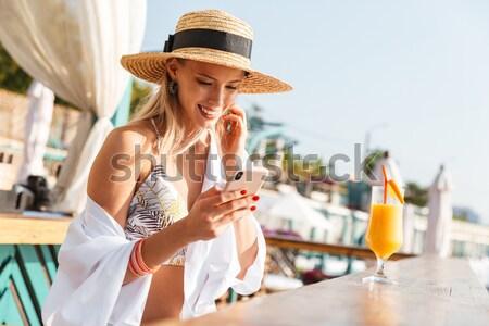 Erfreut junge Mädchen Sommer hat Badebekleidung ruhend Stock foto © deandrobot