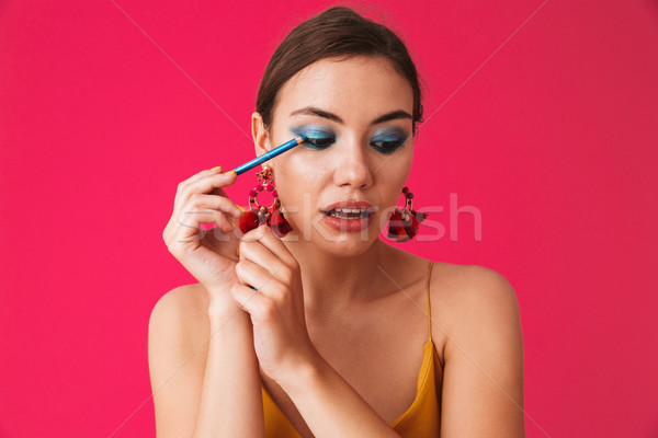 Foto jonge vrouw 20s oorbellen Stockfoto © deandrobot