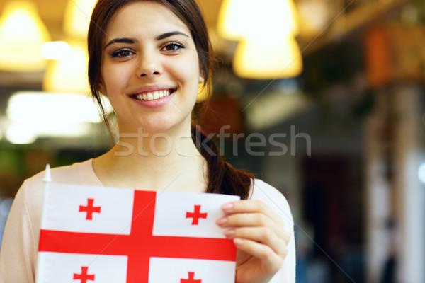 Sonriendo femenino estudiante bandera Georgia Foto stock © deandrobot