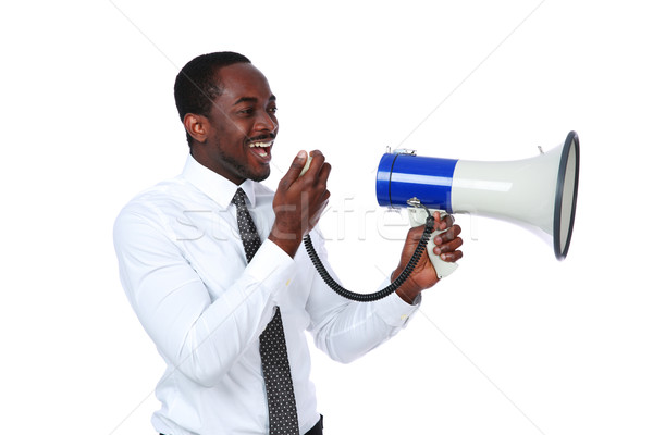 African man yelling through a megaphone isolated on a white background Stock photo © deandrobot