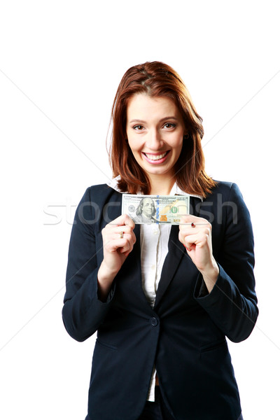 Smiling businesswoman holding US dollars isolated on a white background Stock photo © deandrobot