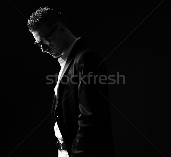 Black and white photo of a thoughtful businessman in glasses Stock photo © deandrobot