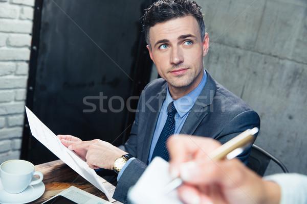 Man making order at restaurant Stock photo © deandrobot