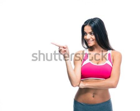 счастливым Фитнес-женщины указывая пальца далеко изолированный Сток-фото © deandrobot