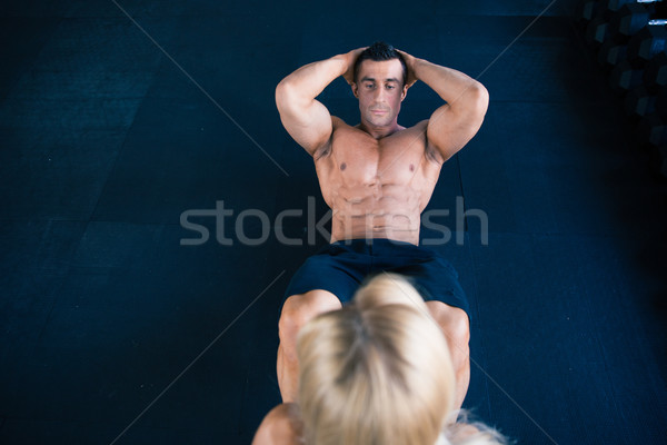 Muscular man doing abs exercise Stock photo © deandrobot