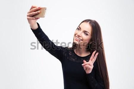 Woman in black fashion dress making selfie photo Stock photo © deandrobot