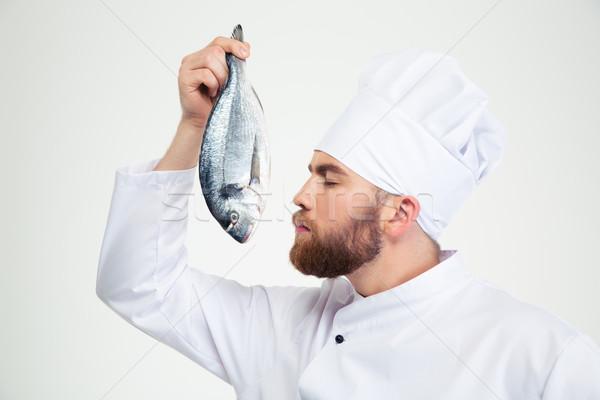 Mannelijke chef kok vers vis portret Stockfoto © deandrobot