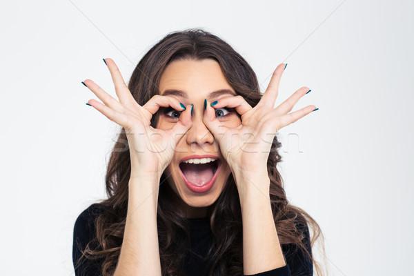 Dziewczyna patrząc kamery palce portret funny Zdjęcia stock © deandrobot