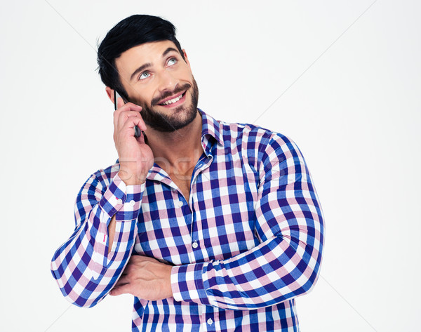 Man talking on the phone and looking up Stock photo © deandrobot