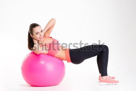 Mooie jonge fitness vrouw roze top Stockfoto © deandrobot