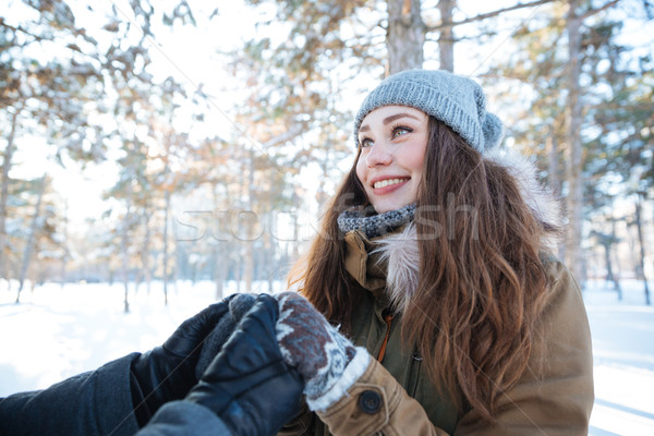 Beautiful cheerful woman holding hands with her boyfriend Stock photo © deandrobot