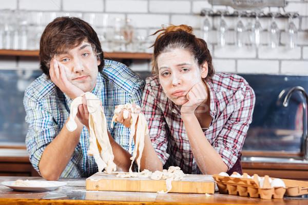Cansado casal farinha faces cozinha Foto stock © deandrobot