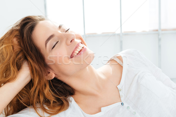 Happy woman with closed eyes Stock photo © deandrobot