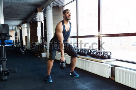 Fitness man working out with kettlebell Stock photo © deandrobot