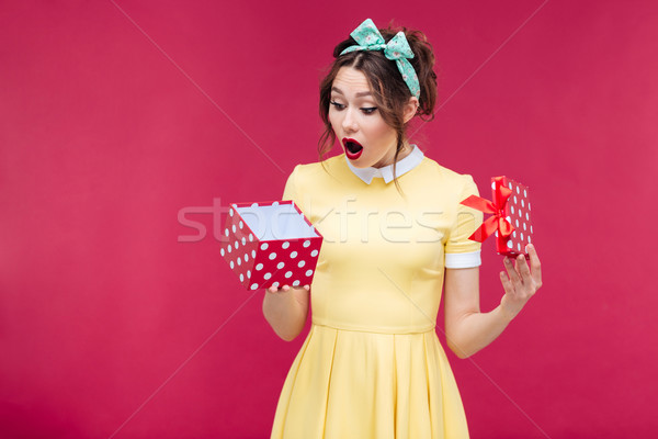 Wondered cute young woman opening gift box Stock photo © deandrobot