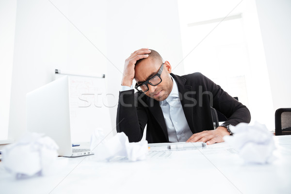 Stressed business man with work problems in the office Stock photo © deandrobot