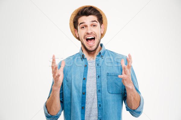 Heureux excité jeune homme célébrer succès Photo stock © deandrobot