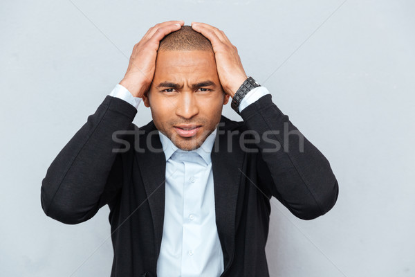 Closeup portrait of unhappy upset guy isolated on gray background Stock photo © deandrobot