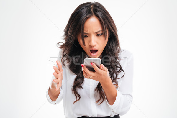 Disappointed asian businesswoman using smartphone Stock photo © deandrobot