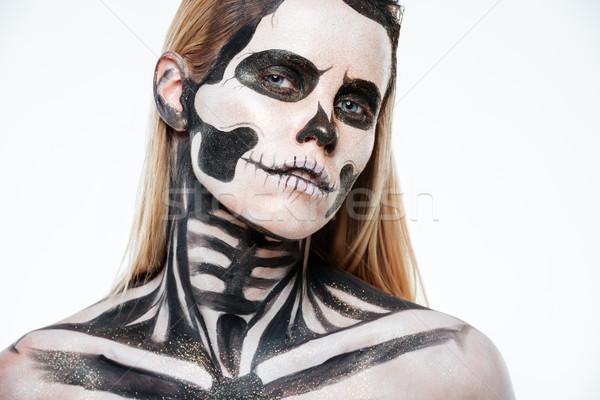 Closeup of woman with halloween skeleton makeup Stock photo © deandrobot