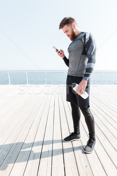 Stock photo: Runner with water and phone