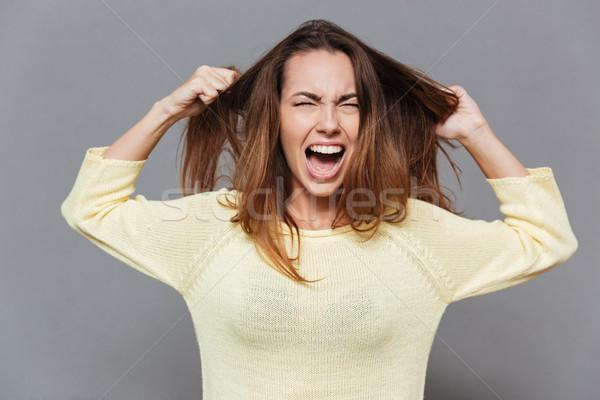 Retrato frustrado zangado mulher gritando fora Foto stock © deandrobot