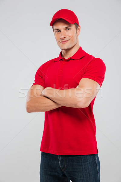 Portrait of deliveryman with arms crossed Stock photo © deandrobot